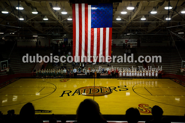 Forest Park and Southridge lined up for the national anthem before Tuesday night's game at Memorial Gymnasium in Huntingburg. The Rangers defeated the Raiders 35-33.   Alisha Jucevic/The Herald