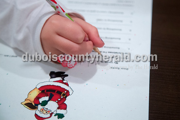 Sarah Shaw/The Herald Madalyn Breeding of Jasper, 7, wrote a letter to Santa during a Letters to Santa Workshop at the Jasper Public Library on Tuesday evening. Mrs. Claus visited the library to share tales from the North Pole and help children write letters to Santa.
