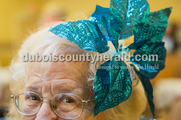 Sarah Ann Jump/The Herald St. Charles Health Campus resident Ruth Buechler wore a poinsettia decoration in her hair at the facility in Jasper on Thursday.