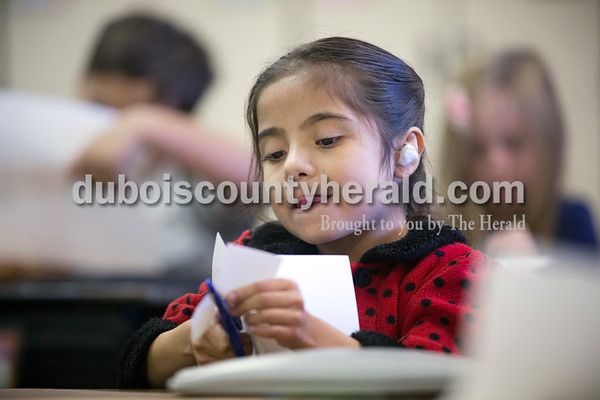 Sarah Ann Jump/The Herald Fifth Street Elementary School first-grader Milagro Alfaro Lopez cut paper for a holiday craft in her classroom at the school in Jasper on Monday, Nov. 21. Milagro had open-heart surgery in July and recently returned to school.