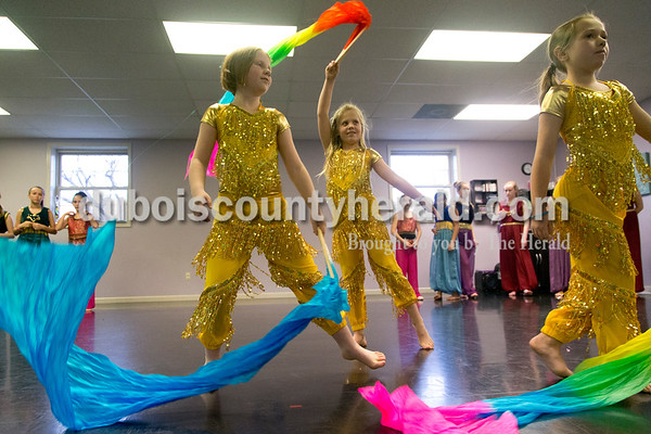 Sarah Shaw/The Herald Kiera Hewitt of Huntingburg, 10, Andyn Lampert of Ireland, 8, and Kennedy Huff of Loogootee, 9, danced with streamers during a rehearsal at Dance Central Academy of Performing Arts in Jasper on Thursday. Students from Dance Central Academy will be performing in the Evansville Children's Center for Dance Education's production of The Nutcracker at the Jasper Arts Center on Saturday at 3 p.m.
