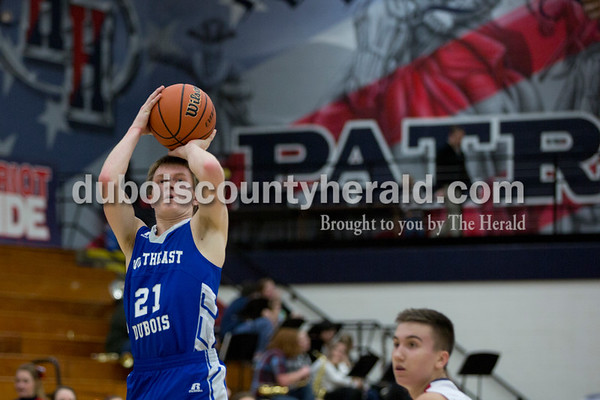 Northeast Dubois' Alex Harder attempted a shot during Saturday's game against Northeast Dubois in Lincoln City. The Patriots defeated the Jeeps 43-36.  Sarah Shaw/The Herald