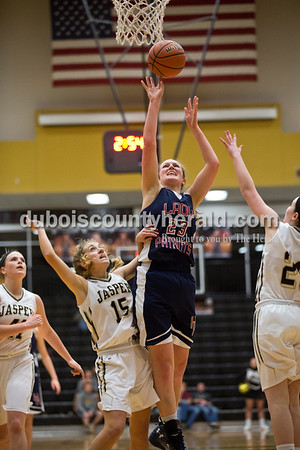 Heritage Hills' Abby Wahl made a basket during Tuesday's girls basketball game in Jasper. Heritage Hills defeated Jasper 67-60. Sarah Ann Jump/The Herald