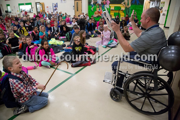 Sarah Shaw/The Herald Pine Ridge Elementary School principal Ryan Haas sat in a wheelchair while students sang happy birthday to him on Friday morning. Students and staff at Pine Ridge Elementary School dressed up as old people to surprise principal Ryan Haas who is celebrating his 40th birthday today.