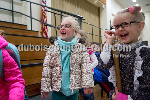 Sarah Shaw/The Herald Pine Ridge Elementary School preschoolers Hailey Workman, left, and Addison Hill sang Happy Birthday to principal Ryan Haas on Friday morning. Students and staff at Pine Ridge Elementary School dressed up as old people to surprise Haas who is celebrating his 40th birthday today.
