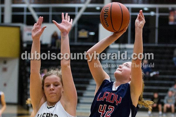 Jasper's Maria Gobert defended as Heritage Hills' Sydney Scherry shot during Tuesday's girls basketball game in Jasper. Heritage Hills defeated Jasper 67-60. Sarah Ann Jump/The Herald