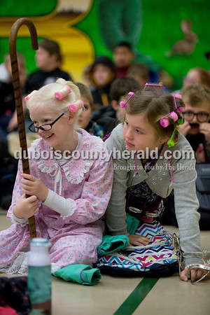 Sarah Shaw/The Herald Pine Ridge Elementary School second-graders Leigha Nord and Avery Hill dressed up like old people to surprise surprise principal Ryan Haas who is celebrating his 40th birthday today.