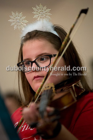 Sarah Ann Jump/The Herald Aoibhinn Rasche of St. Anthony, 10, played the violin in a Christmas program with Strings, Inc. at Brookside Village Senior Living Community in Jasper on Monday evening.