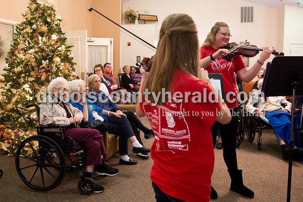 Sarah Ann Jump/The Herald Kaelyn Klopfenstein of Loogootee, 14, center, and director Amber McNair of Huntingburg played in a Christmas program with Strings, Inc. at Brookside Village Senior Living Community in Jasper. Strings, Inc. is a violin school based in Jasper, Huntingburg and Ferdinand. They play an annual Christmas show at Brookside Village.