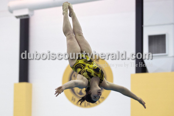 Jasper High School senior Sarah Smith worked on back and reverse dives during practice after school on Monday in the JHS Natatorium. During Smith's first year and fourth meet of her diving career, she broke JHS's six-dive score record.  Alisha Jucevic/The Herald