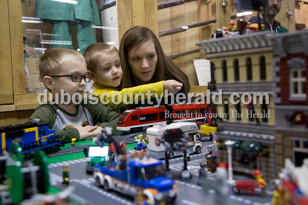 Sarah Shaw/The Herald Braxton Dupps of Jasper, 6, left, his younger brother Ethan, 3, and his mother Ashley inspected a model train layout made entirely of LEGOs during the Model Train Show at the Dubois County Museum in Jasper on Saturday. The show featured over 20 vendors selling different types and sizes of train cars, sets, toys and accessories, as well as several train layouts throughout the museum.