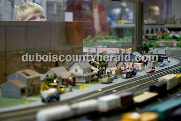 Sarah Shaw/The Herald Joseph Turner of Otwell, 8, watched model trains navigate around a track during the Model Train Show at the Dubois County Museum in Jasper on Saturday. The show featured over 20 vendors selling different types and sizes of train cars, sets, toys and accessories, as well as several train layouts throughout the museum.