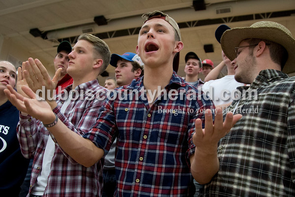 Heritage Hills High School senior Ethan Griepenstroh, center, reacted to a call by the referee during Saturday's game against Northeast Dubois in Lincoln City. The Patriots defeated the Jeeps 43-36.  Sarah Shaw/The Herald