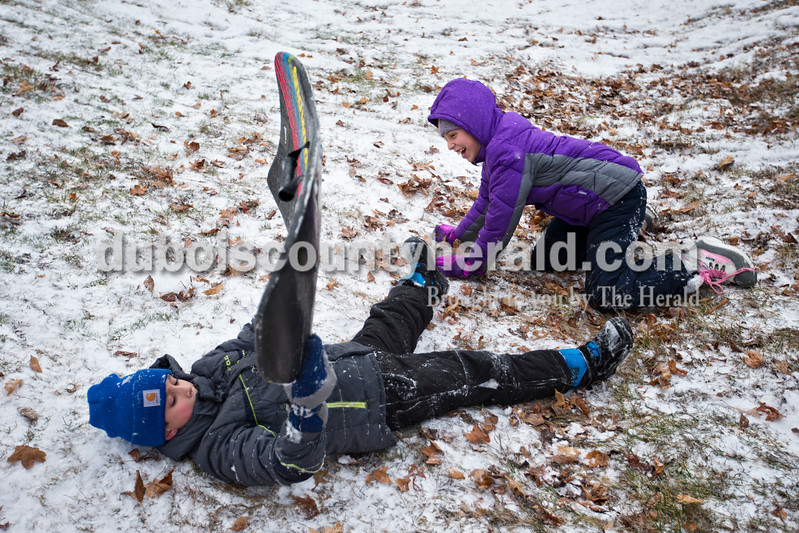 Ayden Dale, 10, and his sister Ansley, 13, both of Jasper sledded with neighborhood friends this morning in Jasper. Snow began to fall early this morning, and all four Dubois County school districts called off classes. <br /> <br /> Alisha Jucevic/The Herald
