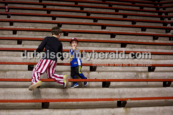 From left, Owen Blessinger of Huntingburg, 8, and Graham Bolling of Huntingburg, 4, played after watching Southridge defeat Tecumseh during Friday's basketball game in Huntingburg. Southridge won 52-38. Tegan Johnston/The Herald