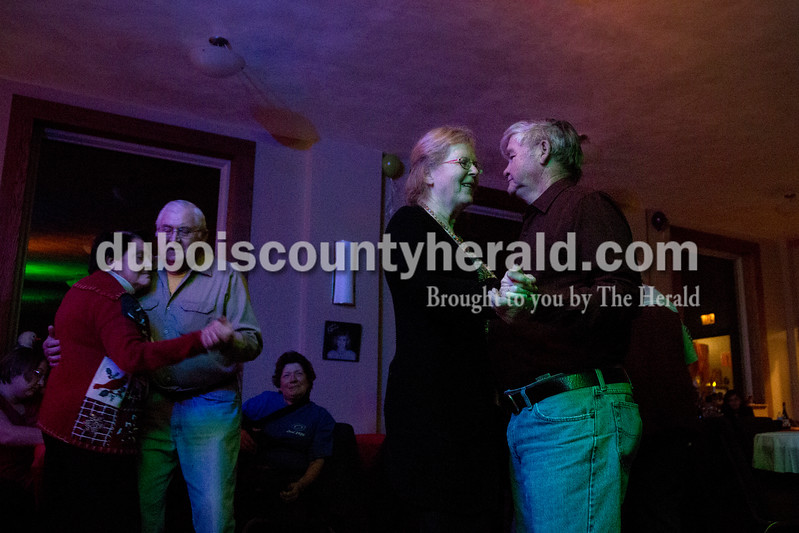 Sarah Shaw/The Herald<br /> Carolyn Winkler, left, danced with Harold Hoing, both of Ferdinand while Dorothy Hendrix of Huntingburg danced with Harry Burkhardt of Princeton during a New Year's Eve dance at the Huntingburg Opry Hall in Huntingburg on Saturday.