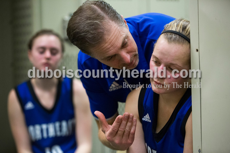 Northeast Dubois assistant coach Kevin Denu talked to Jessica Kahle in the locker room at halftime during Tuesday's girls basketball game in Ferdinand. Forest Park defeated Northeast Dubois 51-42. Sarah Ann Jump/The Herald