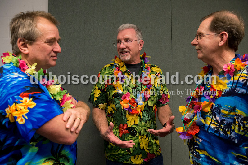 "Sarah Ann Jump/The Herald<br /> Greg Luegers of Jasper, left, Steve Schuler of Eugene, Ore. and Stan Stewart of Haysville talked about memories during a luau-themed celebration of life in memory of Colin Gill at the Jasper Arts Center on Wednesday. The three men along with Gill referred to themselves as ""The Hunt Group"", a running joke about their golf foursome that dates back over 20 years."