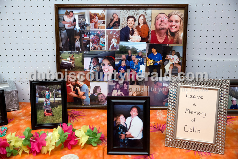 Sarah Ann Jump/The Herald<br /> Photographs of Colin Gill and his family were displayed during a luau-themed celebration of life at the Jasper Arts Center on Wednesday.