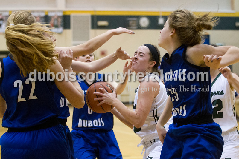 Forest Park's Avie Gould was swarmed by Northeast Dubois defense during Tuesday's girls basketball game in Ferdinand. Forest Park defeated Northeast Dubois 51-42. Sarah Ann Jump/The Herald
