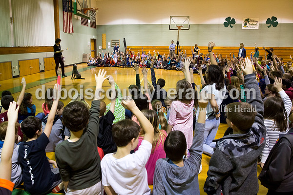 Sarah Ann Jump/The Herald Ireland Elementary School fourth- and fifth-graders raised their hands to volunteer to demonstrate obedience with Serena, a therapy dog belonging to Karen Stenftenagel of Ireland, at the school on Thursday.