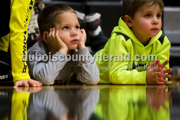 Kellen Brosmer, 4, left, and Bryce Giesler, 3, both of Jasper, watched during Saturday's basketball game in Jasper. Jasper defeated Southridge 57-52. Sarah Ann Jump/The Herald