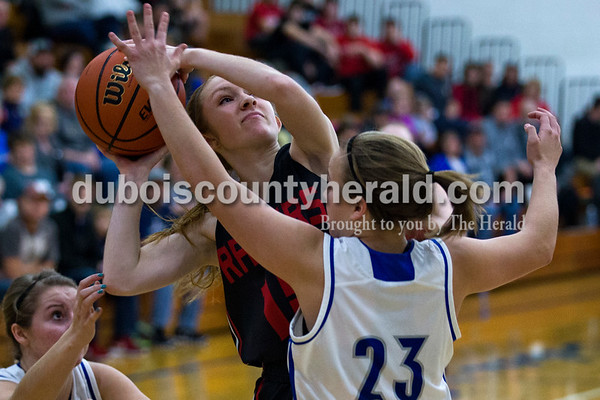 Southridge's Mady Neukam looked to shoot as Northeast Dubois' Jessica Kahle defended her during Tuesday night's game in Dubois. The Jeeps won 42-41.   Alisha Jucevic/The Herald