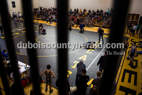 Tegan Johnston/The Herald People gathered to watch and cheer on wrestlers during the 41st annual Folkstyle Open wrestling tournament at Jasper Middle School on Sunday. Children in age divisions pee wee through cadet competed in the event.