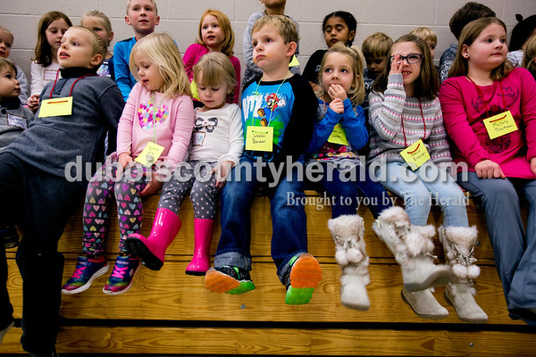 Tegan Johnston/The Herald Waylon Barker of Jasper, 6, center, sat with other children while waiting to be assigned to groups during the Epiphany celebration at St. Joseph Catholic Church in Jasper. The event provided games and story time to teach the children about the arrival of the three kings in the Christmas story.