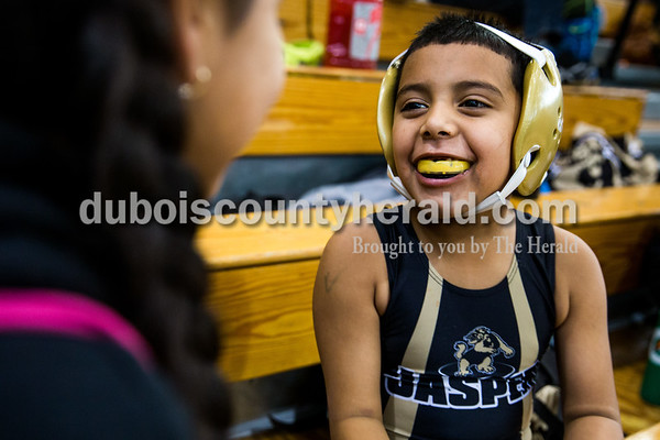 Tegan Johnston/The Herald Marvin Figueroa, 6, and his sister Tiana, 11, both of Jasper, played together between matches during the 41st annual Folkstyle Open wrestling tournament at Jasper Middle School on Sunday. Children in age divisions pee wee through cadet competed in the event.