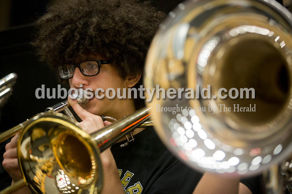 Jasper High junior Nathan DeLeon played the trombone with the pep band during Saturday's basketball game in Jasper. Jasper defeated Southridge 57-52. Sarah Ann Jump/The Herald