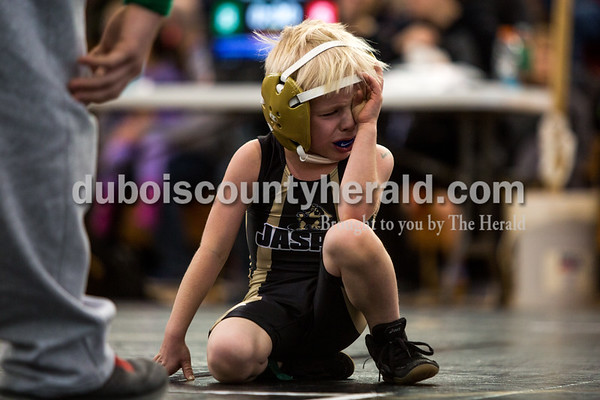 Tegan Johnston/The Herald Ryder Smith of Jasper, 5, wiped his eyes after a match during the 41st annual Folkstyle Open wrestling tournament at Jasper Middle School on Sunday. Children in age divisions pee wee through cadet competed in the event.