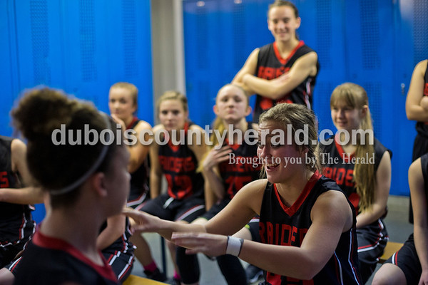 Southridge's Tori Tretter talked with her teammates during halftime at Tuesday night's game against Northeast Dubois in Dubois. The Jeeps won 42-41.   Alisha Jucevic/The Herald