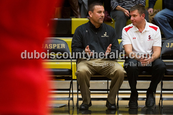 Jasper head coach John Goebel, left, and Southridge head coach Ted O'Brien talked before Saturday's basketball game in Jasper. Jasper defeated Southridge 57-52. Sarah Ann Jump/The Herald