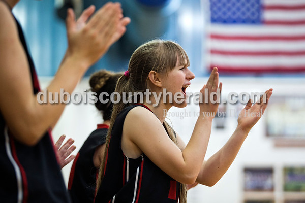 Southridge's Anna Kappner cheered on her team during Tuesday night's game against Northeast Dubois in Dubois. The Jeeps won 42-41.   Alisha Jucevic/The Herald