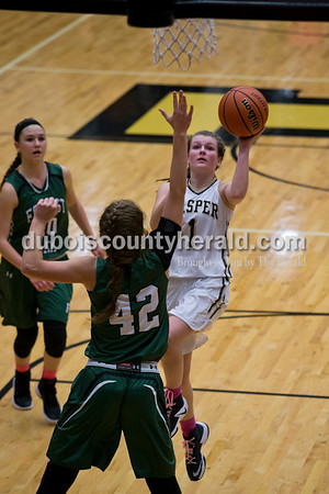 Jasper's Brooke Nottingham, jumped for a layup as Forest Park's Faith Zazzetti (42) reached up to block her during Thursday night's game in Jasper. The Wildcats won 73-70 in overtime.  Alisha Jucevic/The Herald