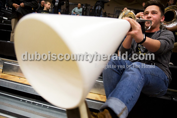Jasper High senior Zach Jones played his trumpet into a megaphone while performing with the pep band during Saturday's basketball game in Jasper. Jasper defeated Southridge 57-52. Sarah Ann Jump/The Herald