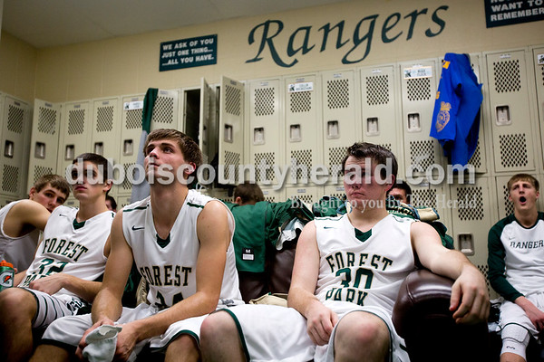 From left, Forest Park's Blake Mohr, Noah Fleck and Trever Zink sat on a couch in the locker room while listening to their coach encourage them at halftime during Friday night's basketball game at Forest Park High School in Ferdinand. Forest Park defeated South Spencer 62-46. Tegan Johnston/The Herald