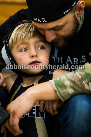 Tegan Johnston/The Herald Jesse Smith of Jasper encouraged his son Jaydan, 6, before his match during the 41st annual Folkstyle Open wrestling tournament at Jasper Middle School on Sunday. Children in age divisions pee wee through cadet competed in the event.