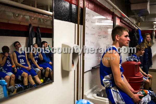 Northeast Dubois's players rehydrated while waiting for their coaches to talk at halftime during Saturday night's basketball game at Memorial Gymnasium in Huntingburg. Northeast Dubois defeated Southridge 49-48. Tegan Johnston/The Herald