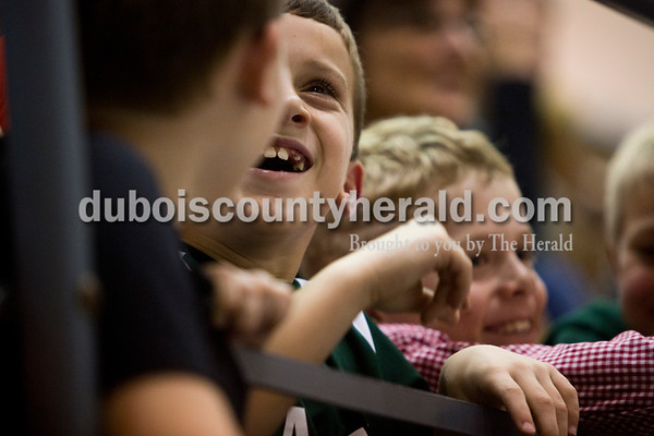 Jared Burger of Ferdinand, 9, laughed while watching Friday night's basketball game with his friends at Forest Park High School in Ferdinand. Forest Park defeated South Spencer 62-46. Tegan Johnston/The Herald