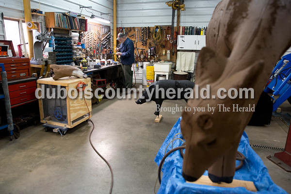 Sarah Ann Jump/The Herald Bob Goodman prepared paint to restore a deer archery target in his workshop at his home in Bretzville on Wednesday.