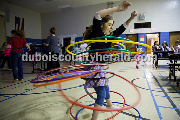 Sarah Ann Jump/The Herald David Turnham Educational Center fourth-grader Anna Deorto hula hooped with 13 hoops during the annual PTO-sponsored sock hop at the school in Dale on Friday.