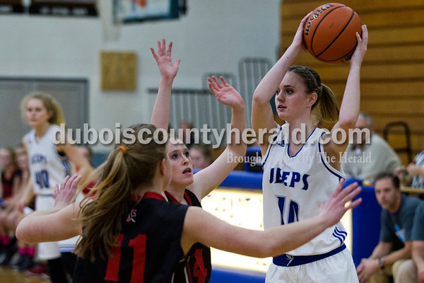 Northeast Dubois' Adison Denu looked to pass as Southridge's Misty Merter and Emily Eckert defended her during Tuesday night's game in Dubois. The Jeeps won 42-41.   Alisha Jucevic/The Herald