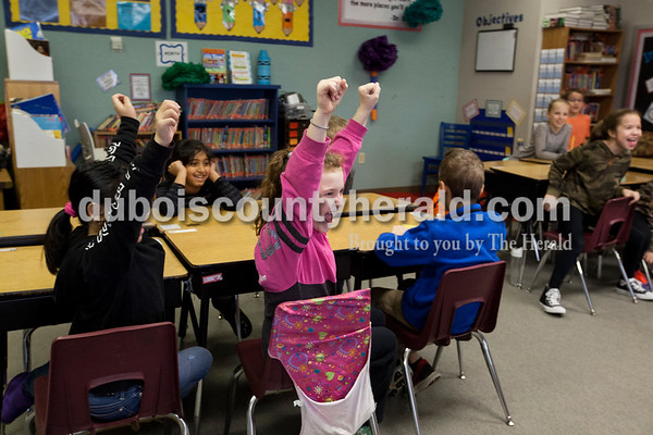 Alisha Jucevic/The Herald  As an early random act of kindness Shannon Bauer informed her students that their science test would be pushed back an extra day. Third-grader Ava Biggs, center, and her classmates cheered at the news.