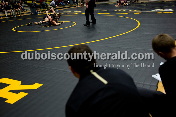 Jasper's and Heritage Hills' coaches watched as their players faced off against each other during Saturday's wrestling match at Jasper Quad Duals in Jasper. Tegan Johnston/The Herald