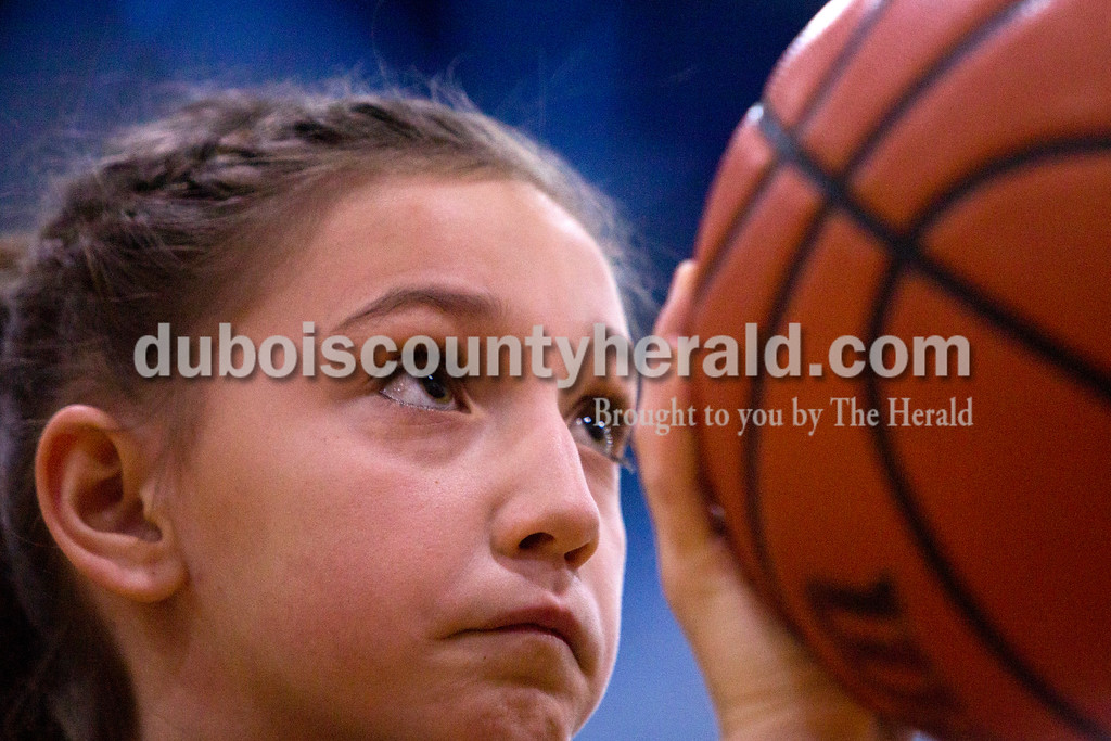 Tegan Johnston/The Herald<br /> Kenzie Cave of Dubois, 9, focused before taking her free throw shot during Sunday afternoon's Free Throw Competition at Dubois Middle School Gymnasium in Dubois. Over 40 boys and girls competed in different age divisions, and the winners of each age group received a trophy, basketball and the opportunity to advance to the district Knights of Columbus competition in February.