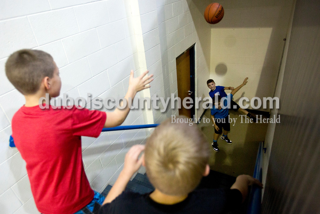 Tegan Johnston/The Herald<br /> Jennings Neukam of Dubois, 10, left, and his brother Gabe, 8, passed a basketball to Landen Goller of Martin County, 10, front, and Eli Schroering of Dubois, 7, during Sunday afternoon's Free Throw Competition at Dubois Middle School Gymnasium in Dubois. Over 40 boys and girls competed in different age divisions, and the winners of each age group received a trophy, basketball and the opportunity to advance to the district Knights of Columbus competition in February.