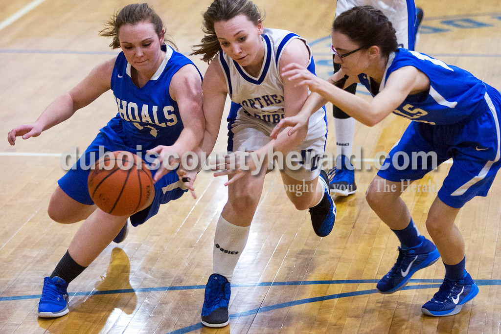 Shoals' Hope Self, left, Northeast Dubois' Chloe Terwiske and Shoals' Ashley Boyd chased the ball during Monday's girls basketball game at Dubois Middle School. Northeast Dubois defeated Shoals 55-21. Sarah Ann Jump/The Herald