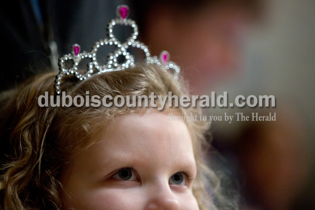 Tegan Johnston/The Herald<br /> Tessa Ginder of Jasper, 4, watched as children were crowned as princes and princesses during Sunday afternoon's Grand Ball at Jasper Middle School in Jasper. Northwood Retirement Community hosted the enchanted event where children dressed-up and were taught to act and dance like real princes and princesses.